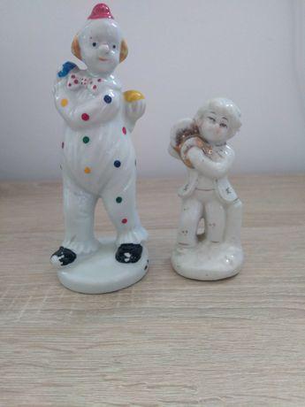 Dwie stare porcelanowe figurki.