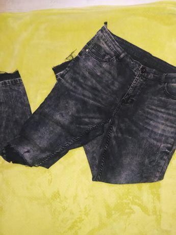 Szare jeansy z przetarciami