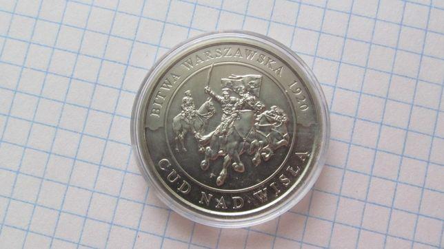 монета в пластмасовій коробочці