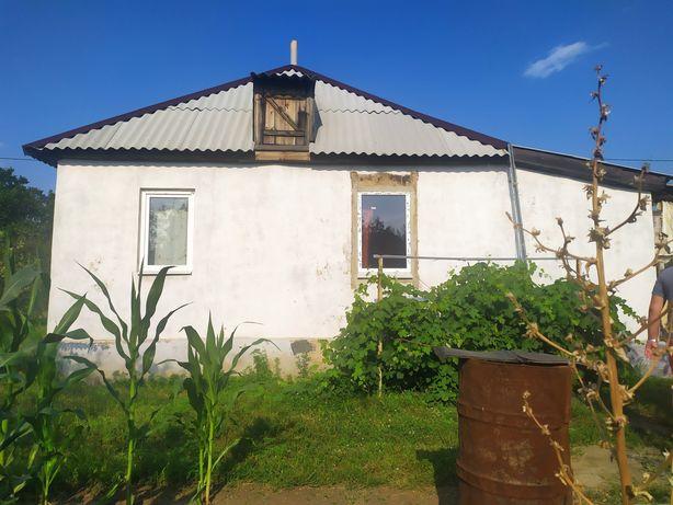 Дом с двумя участками