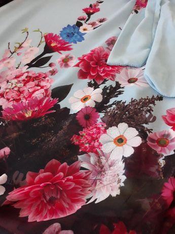 bluzka kwiaty niebieska kolorowa 40 42 bez rękawów