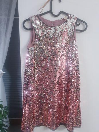 Sprzedam sukienkę  dziewczęcą z cekinów roz. 140