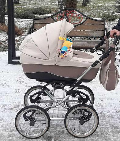 Продам недорого коляску-вездеход Adamex 2 в 1