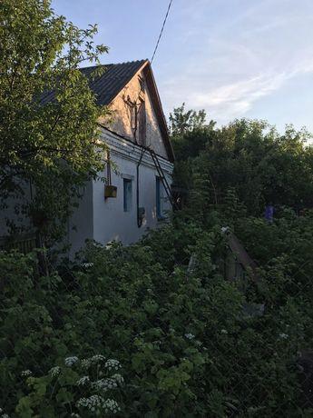 Продам участок, кирпичный дом в тихому районі!