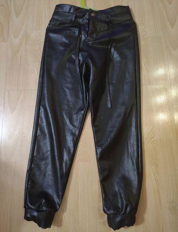 Spodnie ocieplane ala skórzane 128/134 Nowe