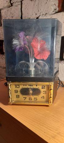 Sprzedam zegar z obracającym się kwiatem