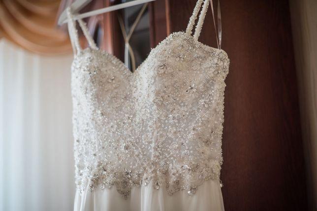 Sprzedam suknie ślubną MGNY (rozmiar 38/40, kolor ivory)