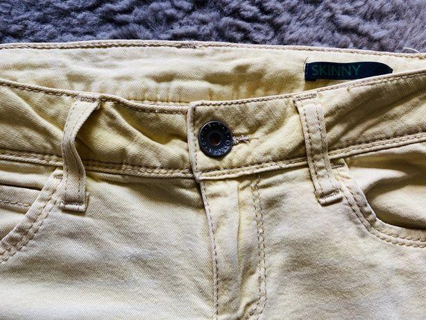Spodnie jeansowe żółte cieniowane Benetton