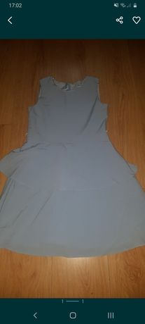 Blekitna sukienka rozm 152