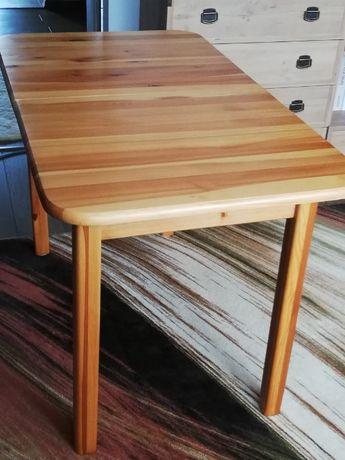 Stół drewniany sosnowy plus 4 krzesła drewniane tapicerowane