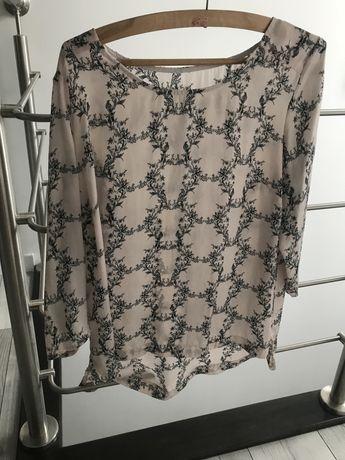 Jasnoróżowa bluzka koszulowa damska