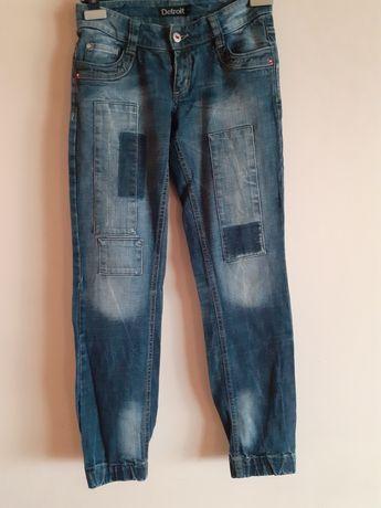 Spodnie jeansowe Lindex joggersy przetarcia dziury łaty