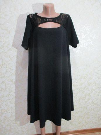 Нарядное чёрное платье трапеция /с вырезом на груди/54-56 р