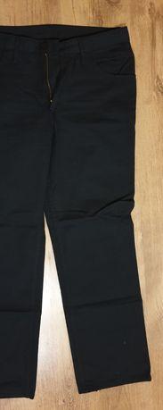Eleganckie spodnie męskie głęboka kieszeń