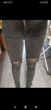 Jeansy spodnie czarne rurki xs 34 z dziurami