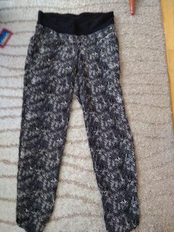 Spodnie ciążowe xs s wężowe wzory