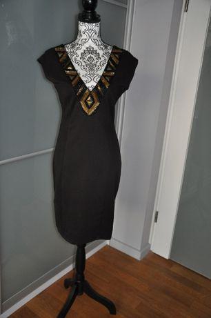 Sukienka prosta ale elegancko wygląda M