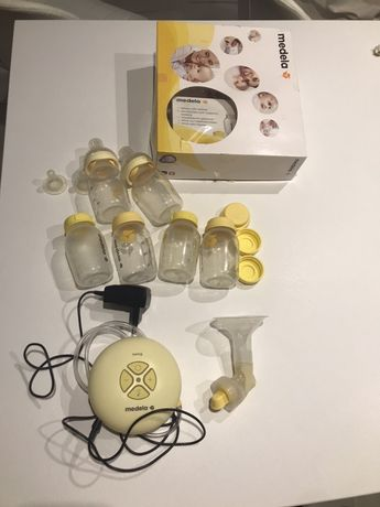 Электрический молокоотсос медела/ medela + бутылки и 2 соски кальма