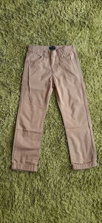 Eleganckie piaskowe spodnie roz. 122 cm