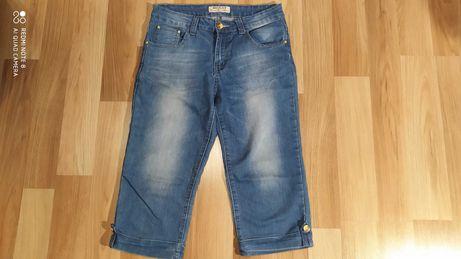 Jeansowe spodnie damskie do kolan