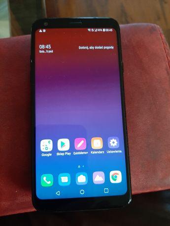 LG Q7  komplet z ładowarką. etui. Sluchawki sportowe w komplecie.