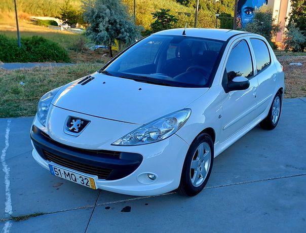Peugeot 206+ ano 2012. 1.1 gasolina aceito trocas