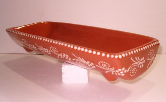 Telha de barro vermelho vidrado