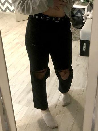 Szerokie spodnie z wysokim stanem i dziurami na kolanach