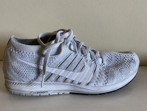 Tenins running Nike
