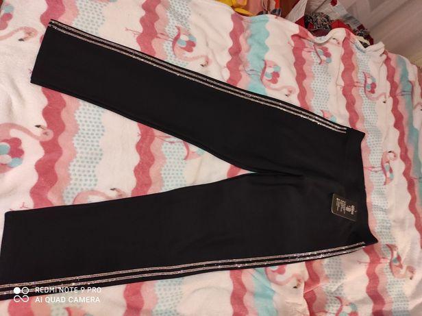 Spodnie z błyszczącą lamówką XL/2XL