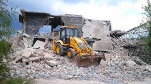 gruz z wyburzenia wywioze kontener koparko ładowarka glina ziemia
