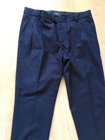 Reserved  nowe eleganckie męskie spodnie