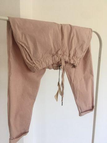 Luźne nowe sportowe eleganckie spodnie na gumce pudrowy róż kieszenie