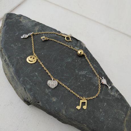 Złota bransoletka z zawieszkami,  złoto 585
