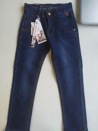 Nowe spodnie jeansy 122/128