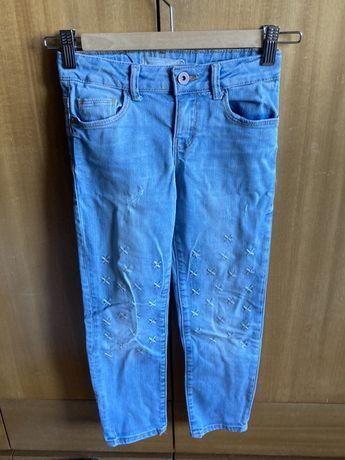 calças de ganga de menina com aplicações