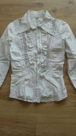 Sprzedam białą koszulę z ręcznie haftowanym wzorem rozmiar 34
