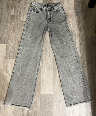 Продам женские джинсы клеш
