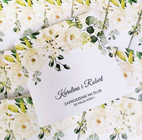 Zaproszenia ślubne z białymi kwiatami i zielenią