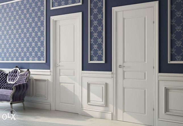 Деревянные крашенные белые двери из массива
