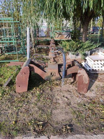 Rotator z łyżką do materiałów sypkich (leśny)