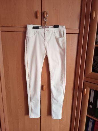 Spodnie rurki kremowe