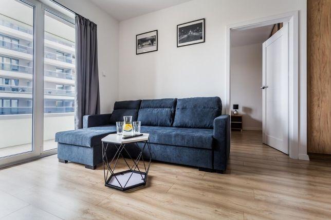 Wygodny apartament na doby z sypialnią w nowoczesnym budynku w centrum