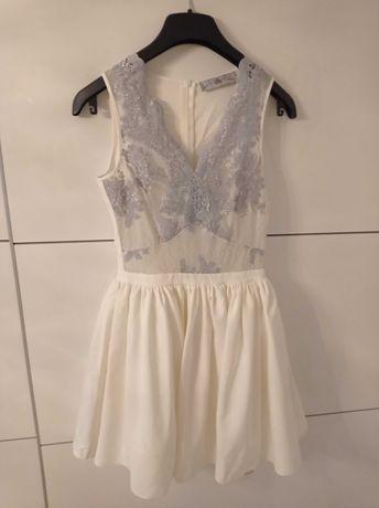 Sukienka biała jak lou