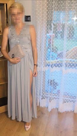 Długa szara z rozporkiem suknia wieczorowa