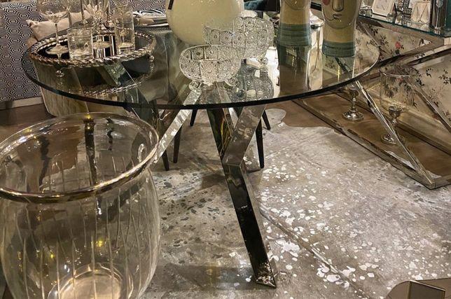 Mesa de jantar redonda em vidro e inox