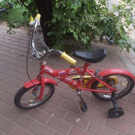 Rowerek czerwony z kulkami