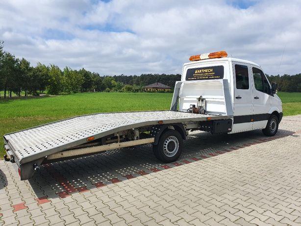 Holowanie pomoc drogowa autolaweta transport pojazdów