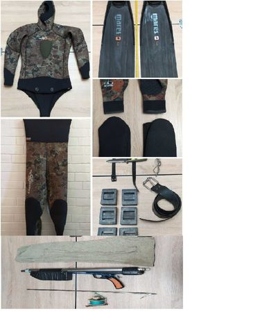 Гидрокостюм и ружье для подводной охоты.
