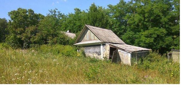 Продам земельну ділянку з будиночком